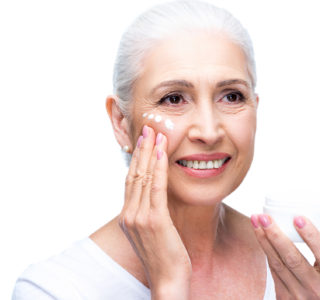 Woman Applying Anti-Aging Cream